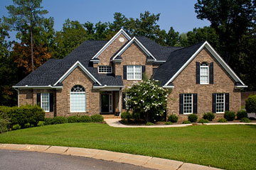 custom brick home on a landscaped lot