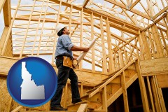 idaho map icon and a custom home builder reviewing construction plans
