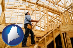 maine map icon and a custom home builder reviewing construction plans