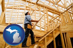 michigan map icon and a custom home builder reviewing construction plans